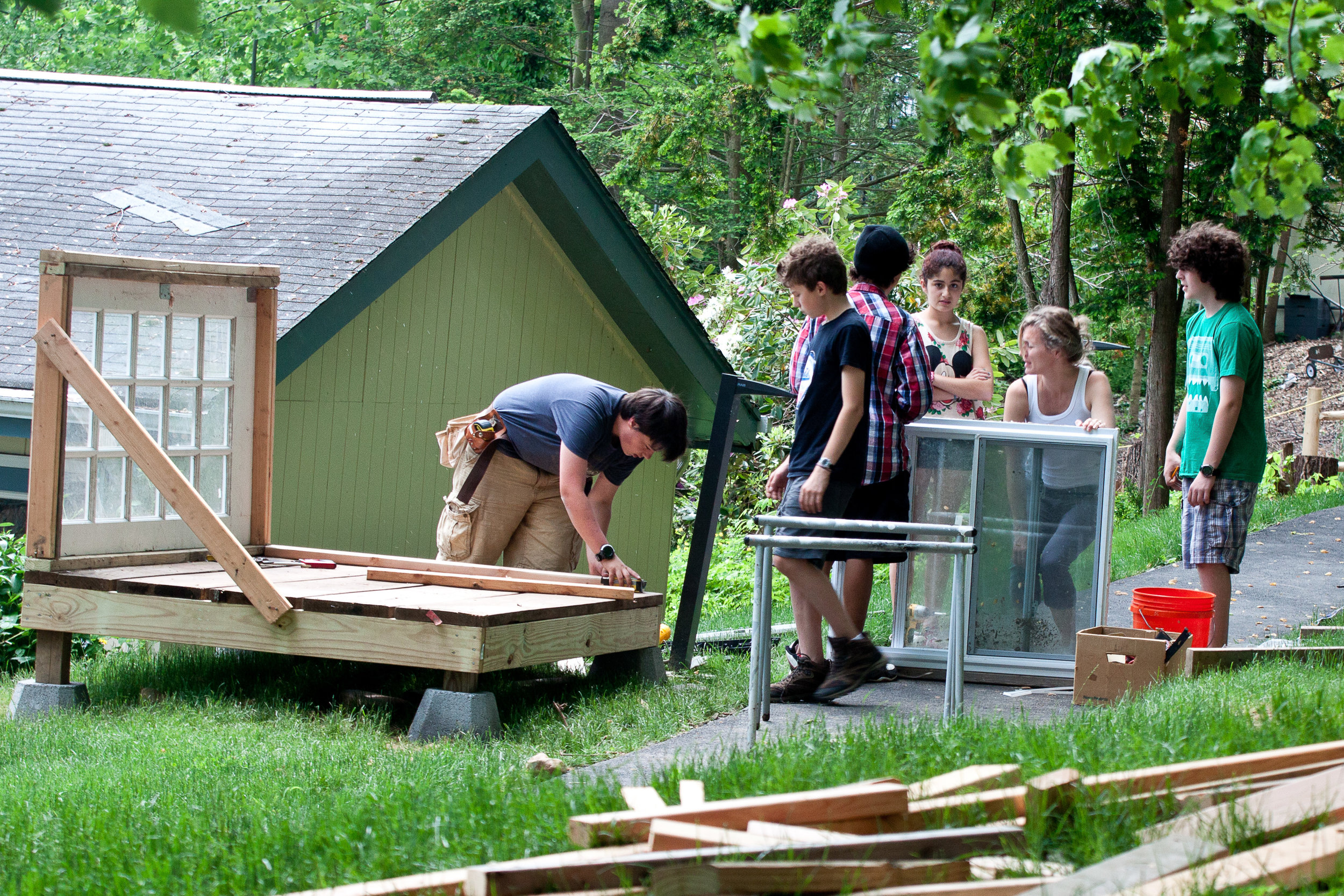 Remy and classmates designing and building a cold frame for the school's gardening program.