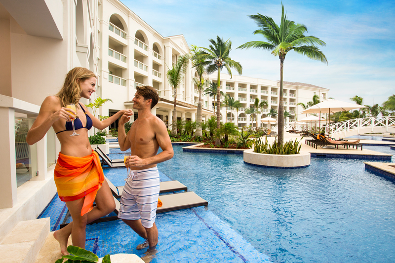 Hyatt-Zilara-Rose-Hall-Couple-In-Swim-Up-Exterior.jpg