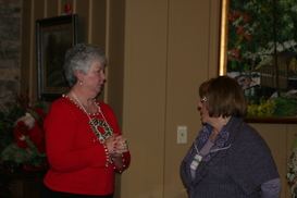 Susie and Donna chat at Holiday Luncheon