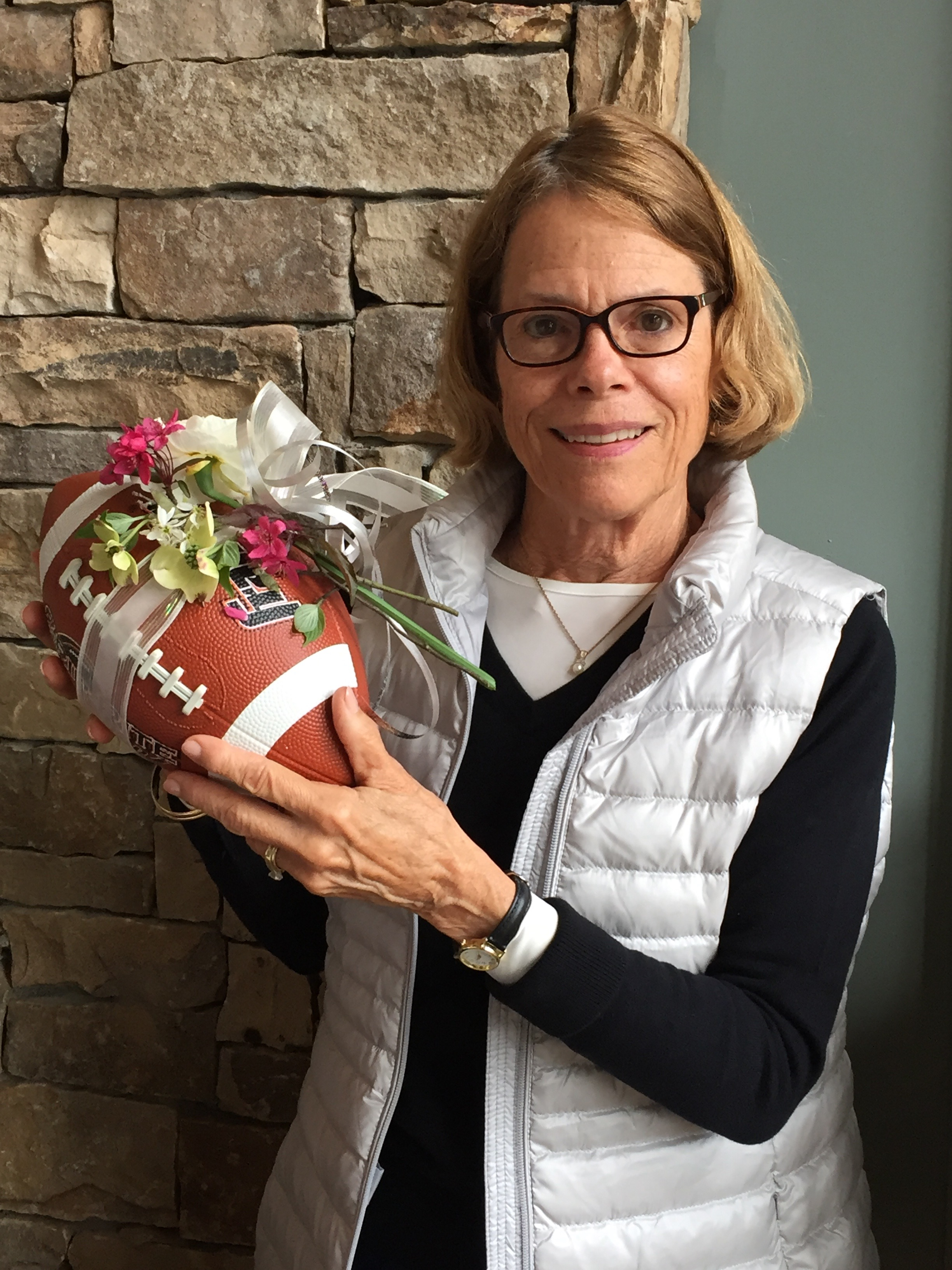 Judy Kaufman, gala chair, had teased the club with the promise of football meets flowers by way of a corsage-wearing football.