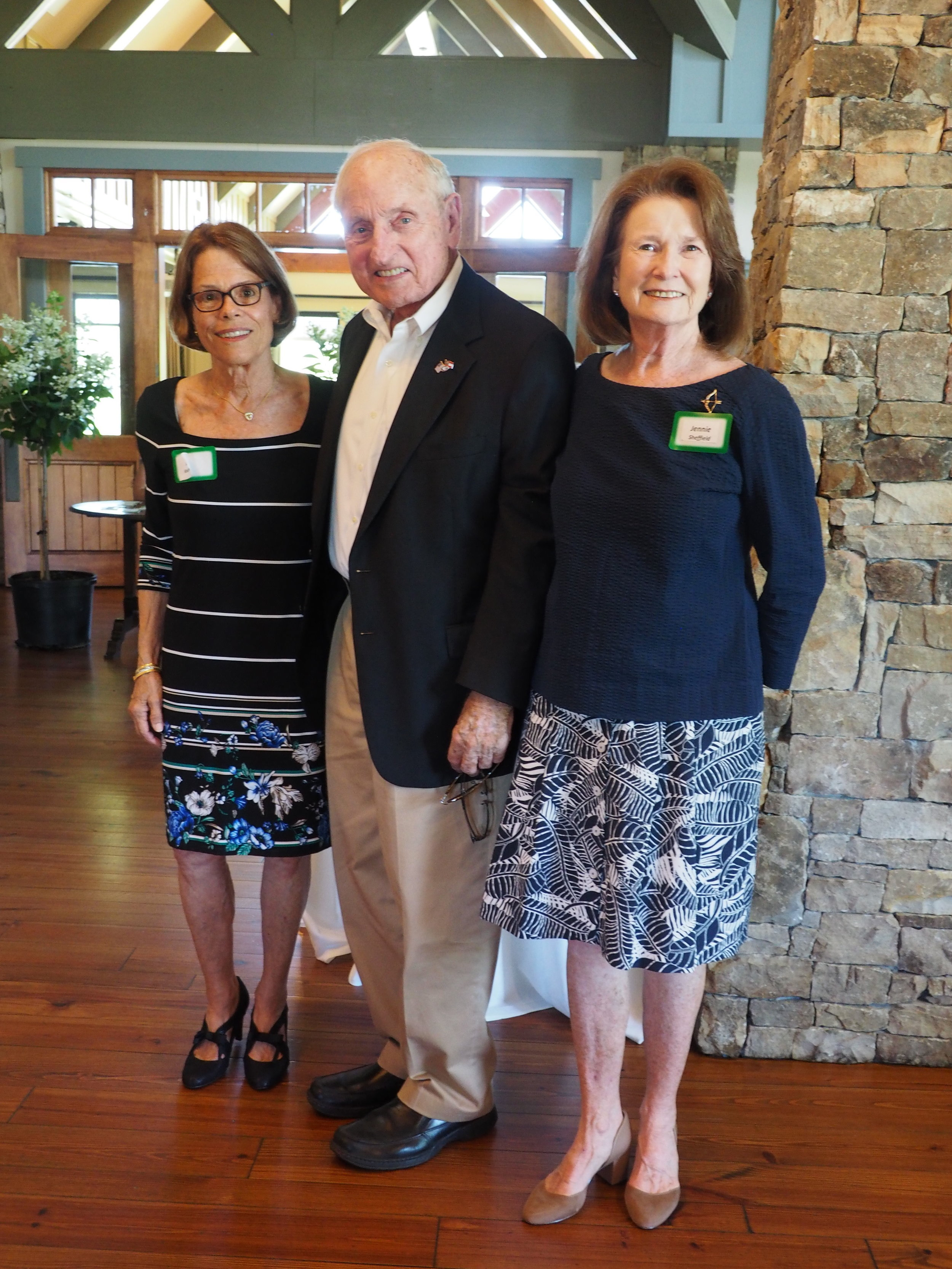 Judy Kaufman and Jennie Sheffield welcome a master of gardening and the former University of Georgia's Coach Vince Dooley, guest speak for the WFB 25th Anniversary celebration.