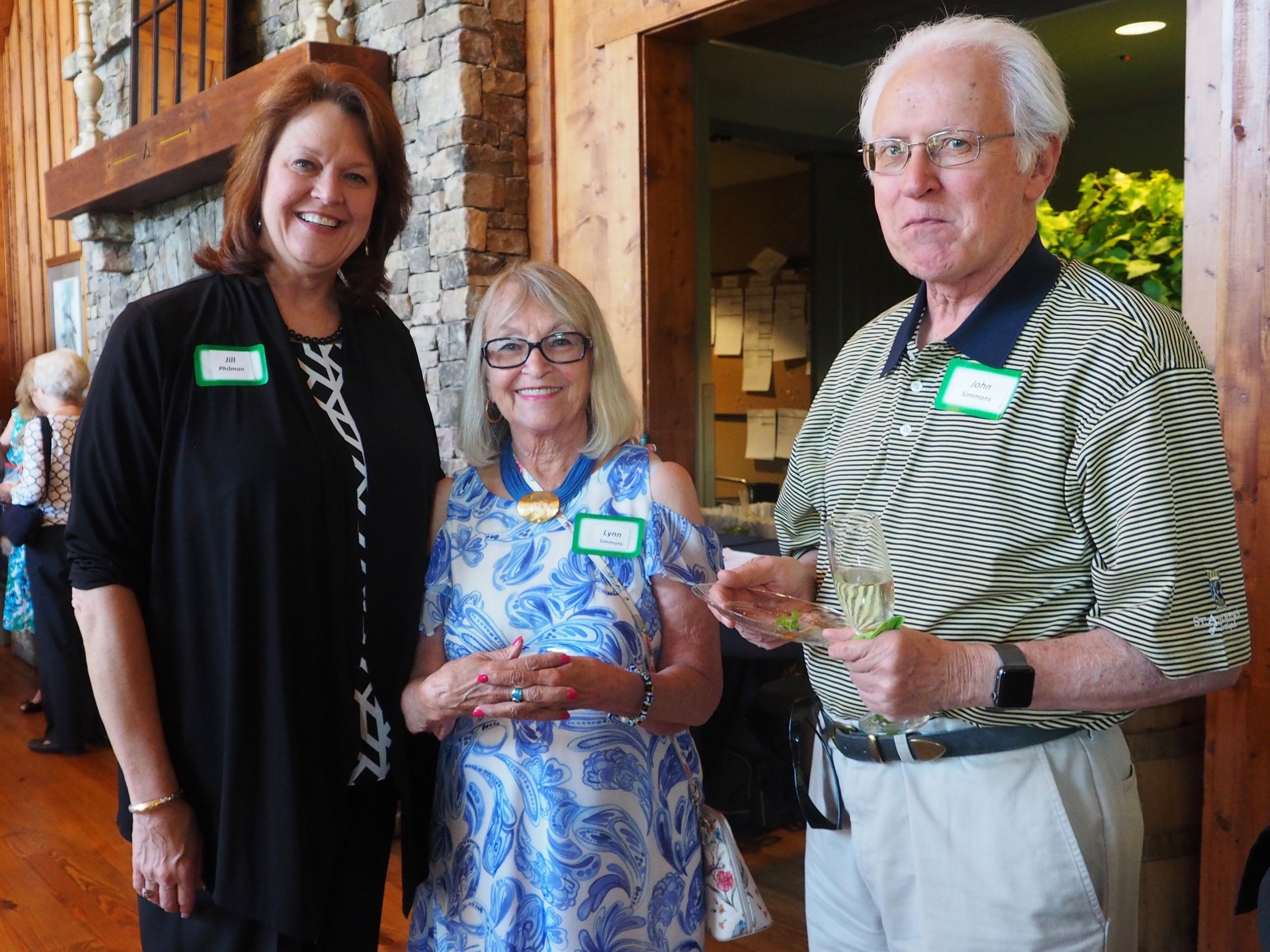 Jill Philmon, Big Canoe general manager, left, with Lynn and John Simmons.