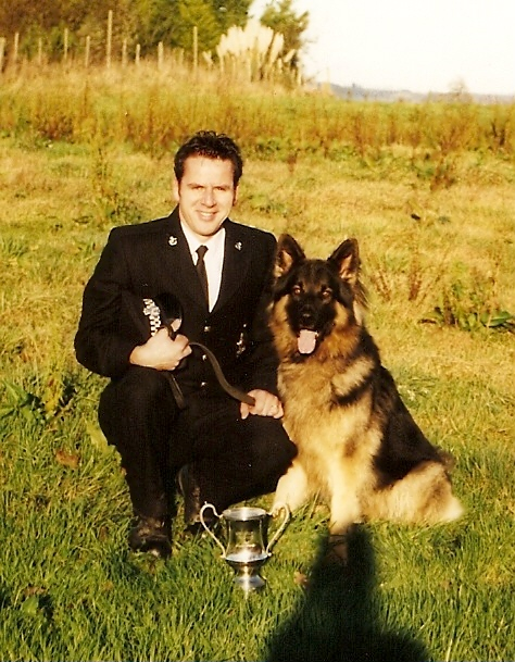Mark, Police Dog Travis and the Novice Dog Trials Trophy