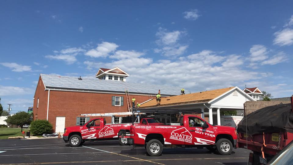 Coates Bros. Roofers working on commercial shingle roof project.