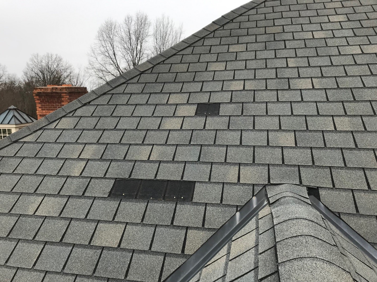 Shingles missing due to wind storm in Northeast Ohio.