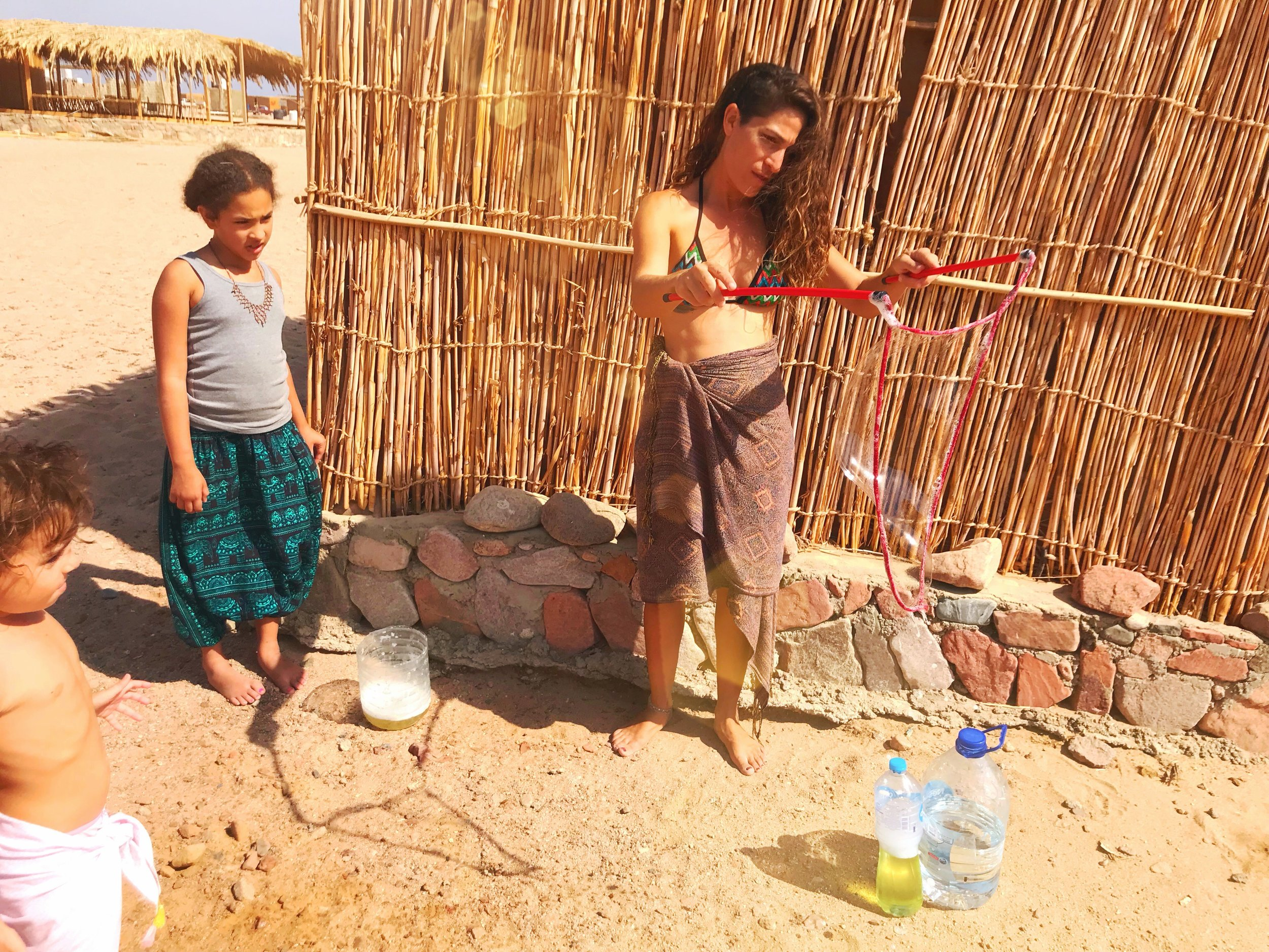 Making bubbles with an Israeli traveler in Abu Galum