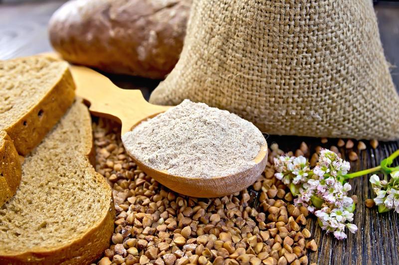 flour-buckwheat-spoon-cereals-bread-board-wooden-bag-table-slices-flower-background-wooden-70641835.jpg