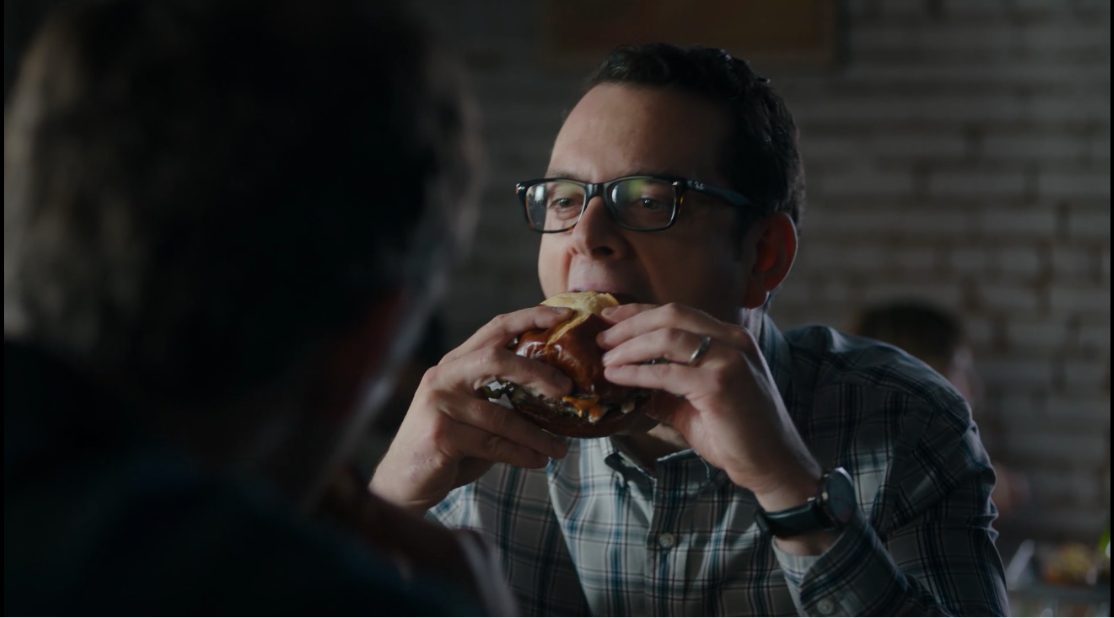 Dig in, Rudy! Dig in! Too bad that he doesn't ultimately get the job. But hey, that burger looks mighty damn fine.