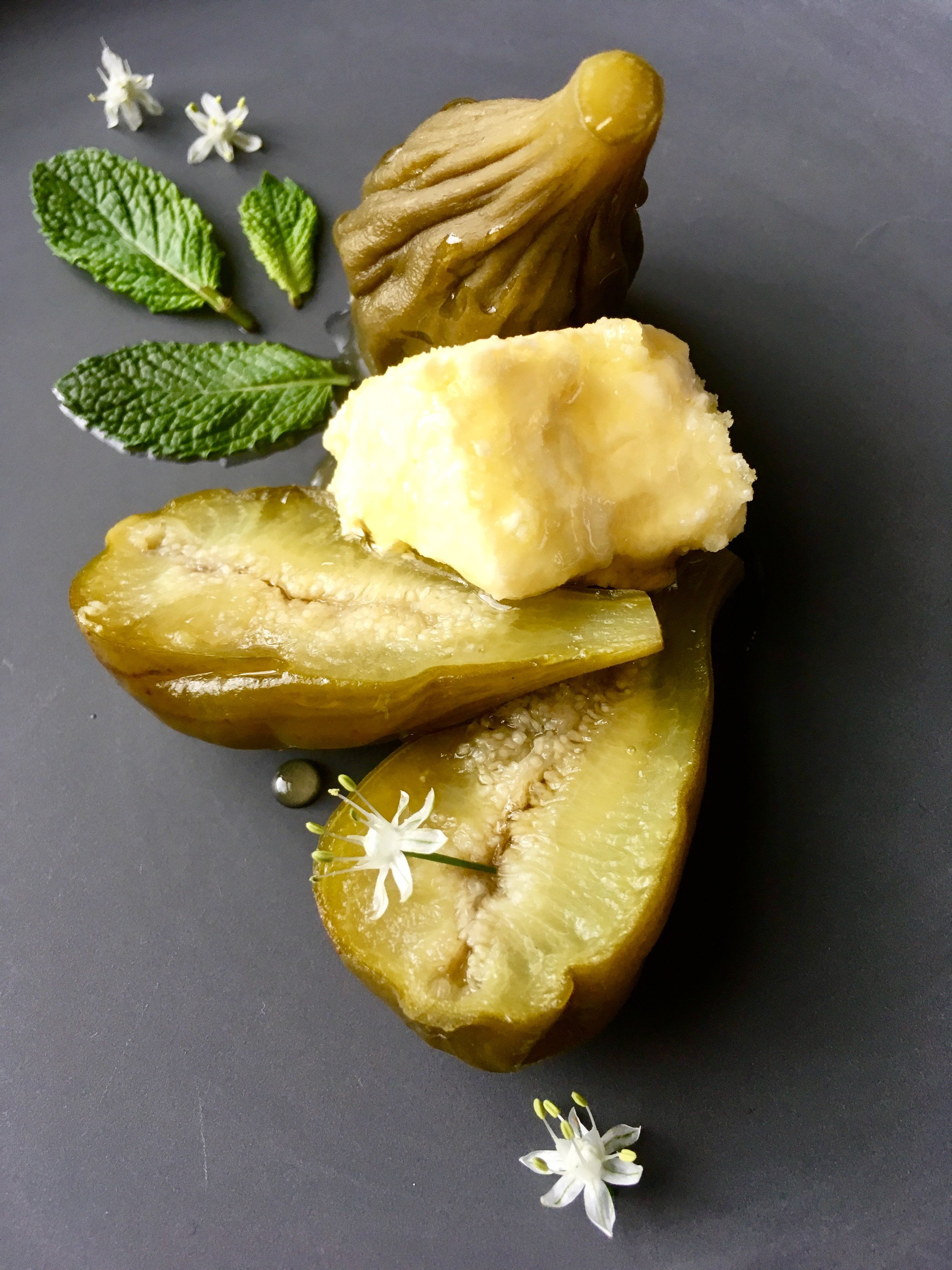Pickled green figs w/ soft curd, honey & mint