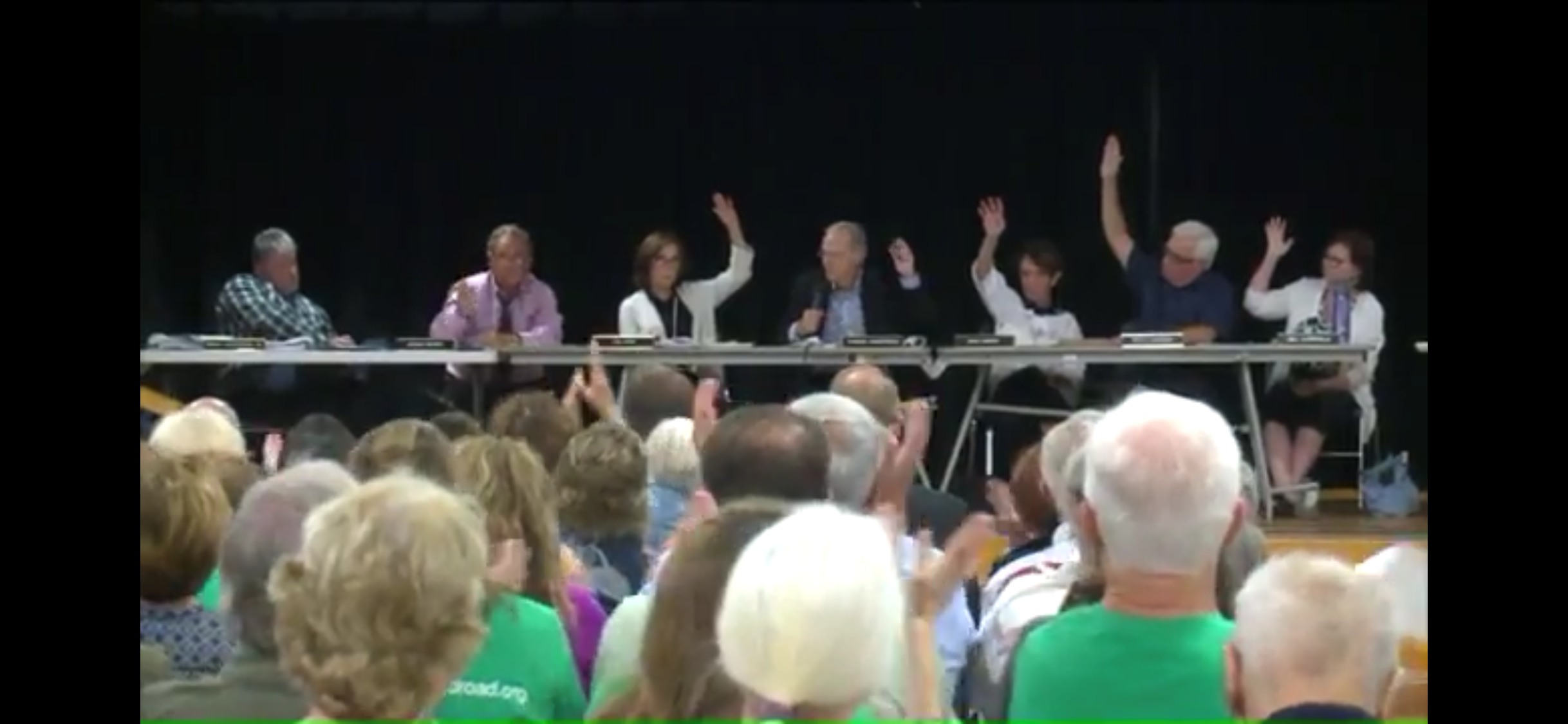6 commissioner raise their hand to vote against the zone change. 1 does not.