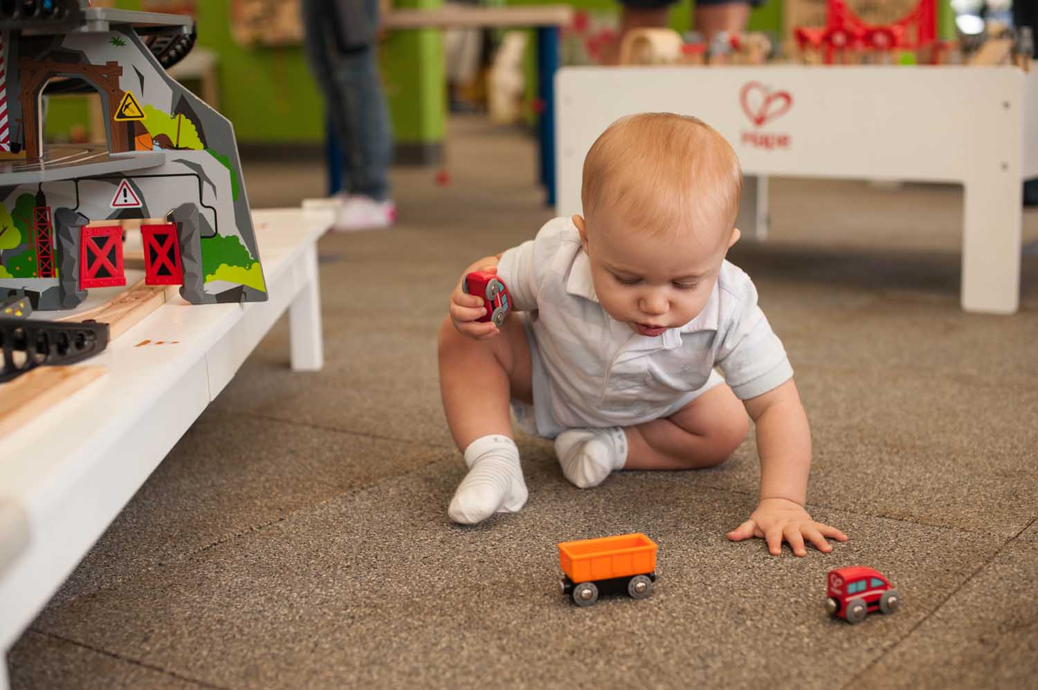 infant-playing-trains.jpg