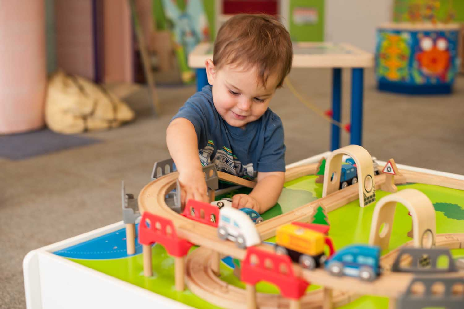 kid-playing-hape-train-table.jpg