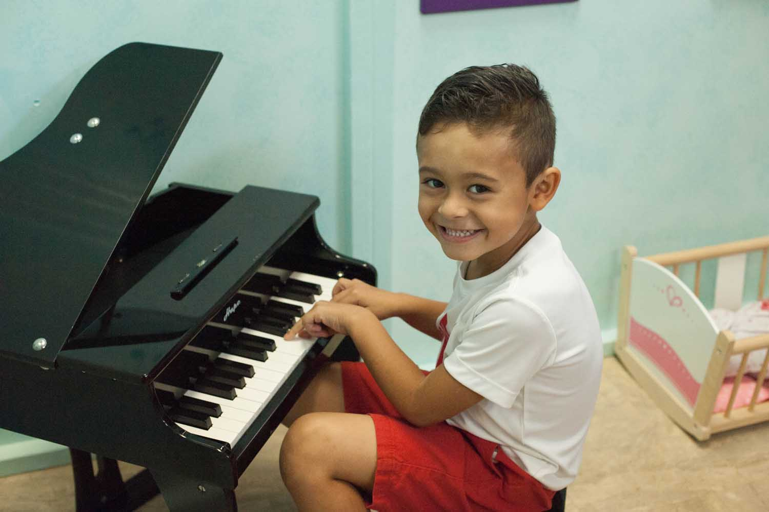 boy-playing-on-toy-piano.jpg