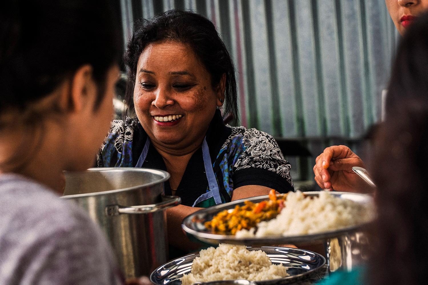 Jivanas-Lunch-Food-Serving-Woman-Rice-Smile-Eating_small.jpg