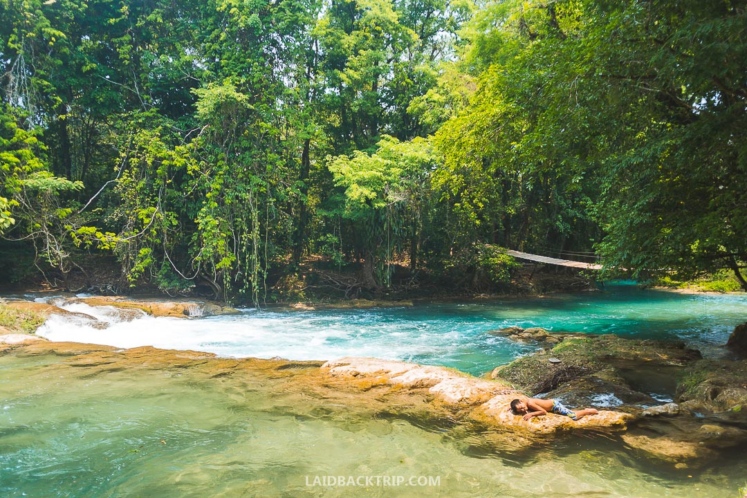You can stay in Palenque overnight before visiting Agua Azul.