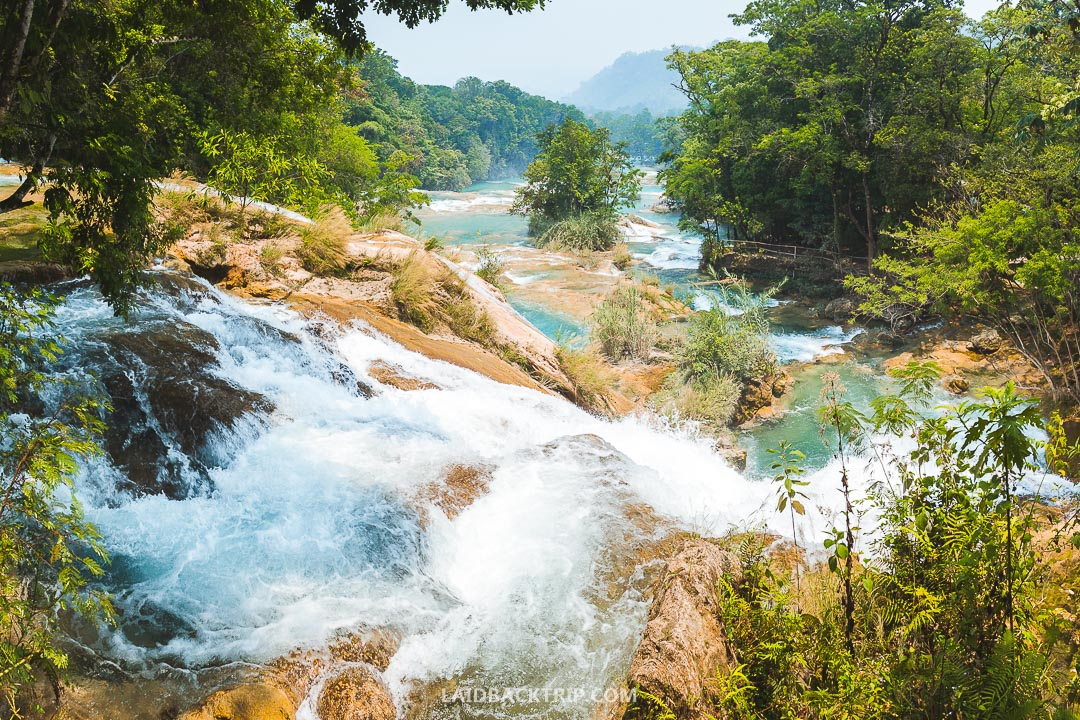 You need to pack three things for Agua Azul day trip - a sunscreen, swimsuit, and camera.