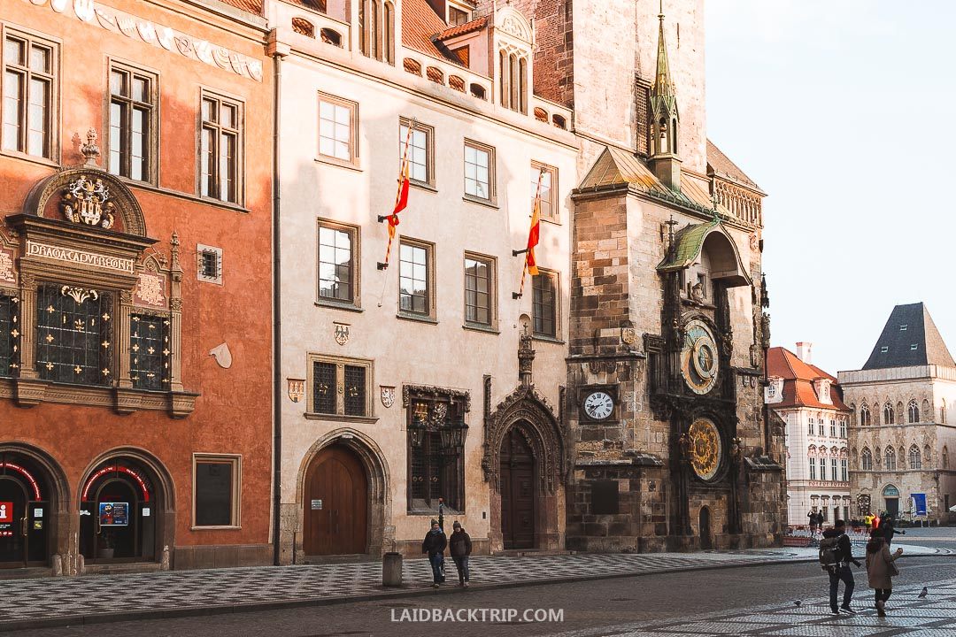 Old Town Square is home to the City Hall, and you can see the Astronomical Clock on the building.