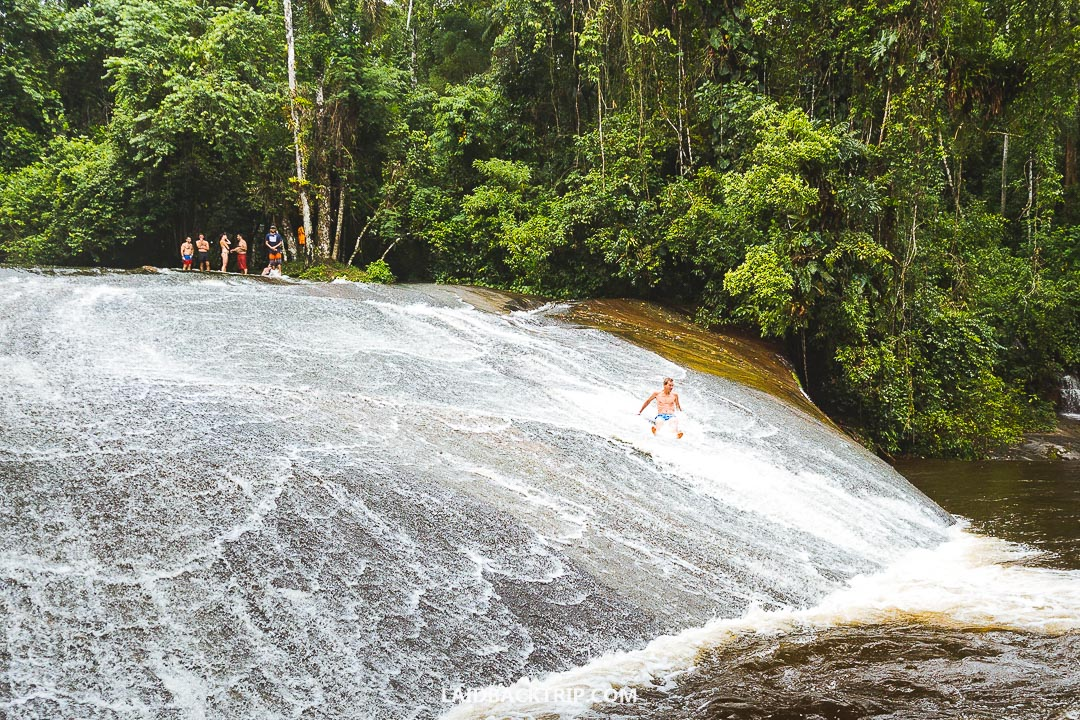 Sliding down the waterfall is a fun activity to do.
