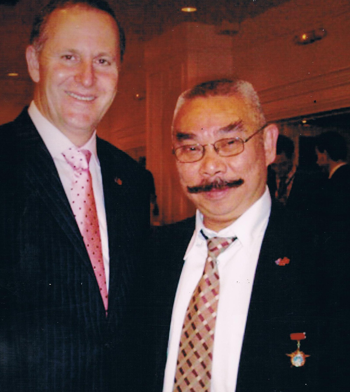 Founder Ken Thai and former PM John Key at an official luncheon with Vietnamese parliament.