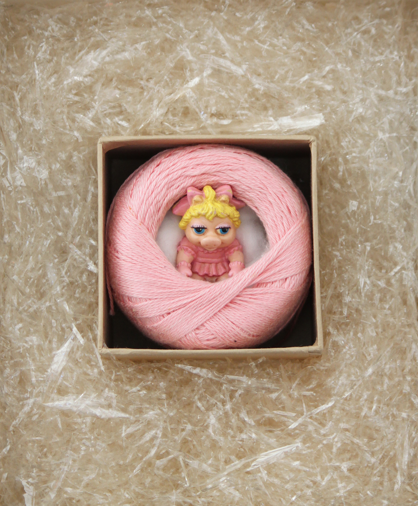TITLE:  Miss Piggy in pink  MEDIUM: Collected and salvaged items DIMENSIONS: H49 x W45cm  FRAMED