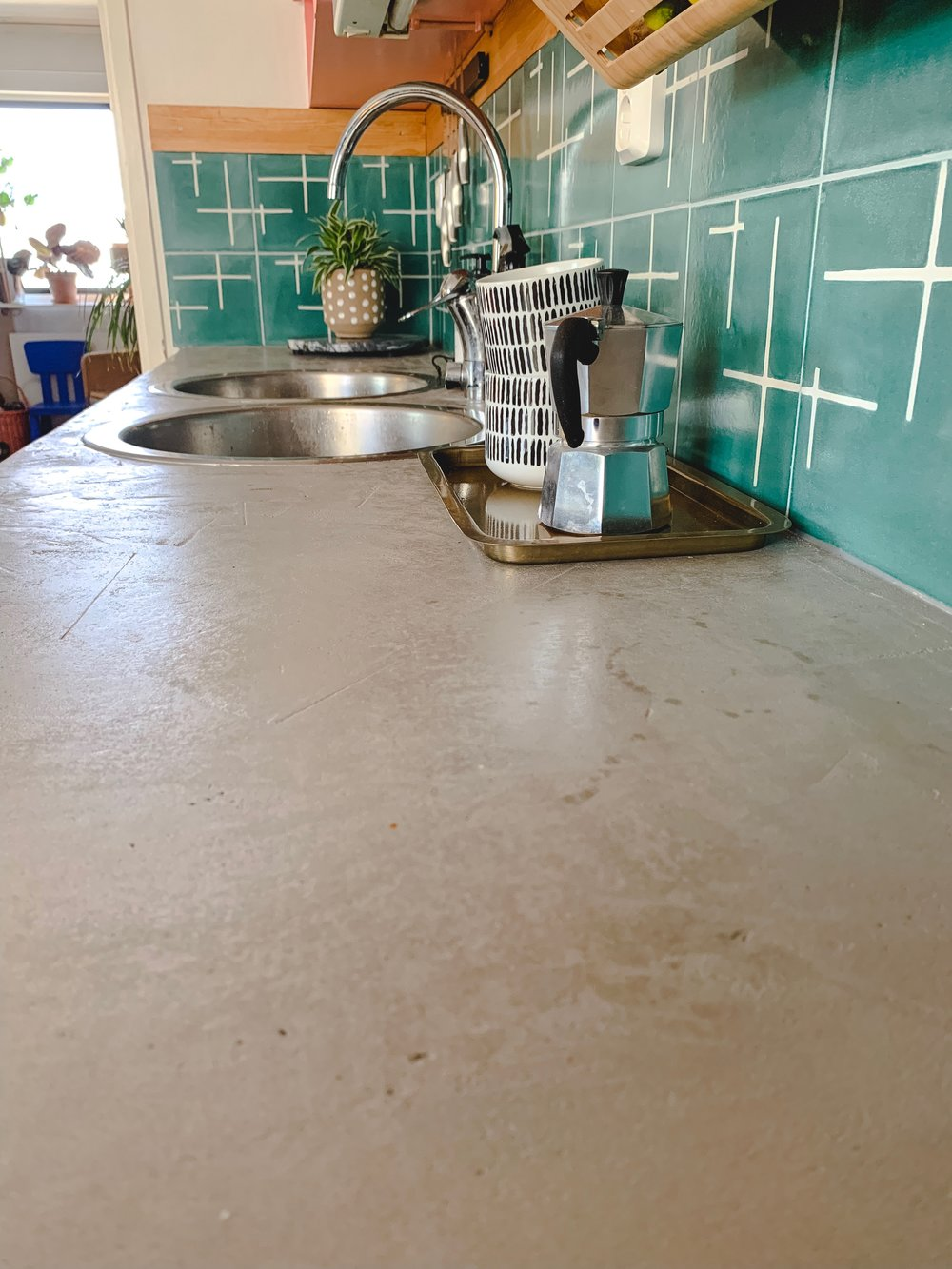Concrete overlay countertop with products supplied by Vitrivius and Design By Cement