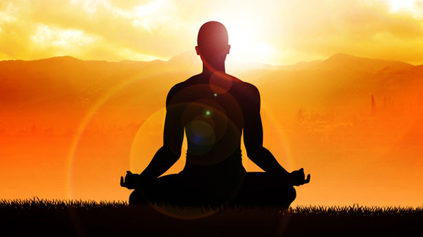 Meditating-in-lotus-position-via-Shutterstock.jpg
