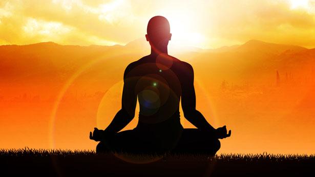 Meditating-in-lotus-position-via-Shutterstock.jpg