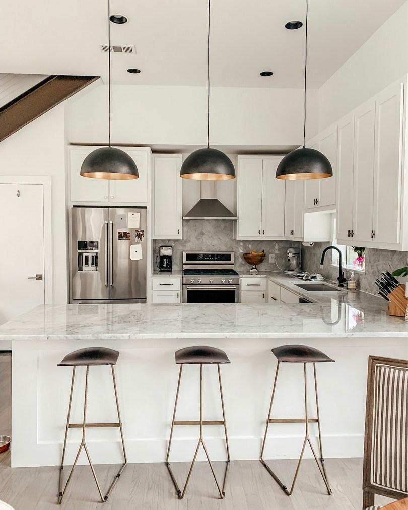 dani-austin-home-update-kitchen-white-marble-black-accents.jpg