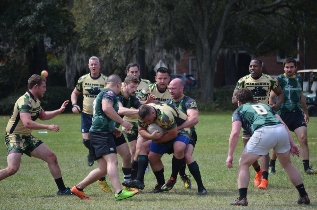 Photo Credit - Meg Thompson Wandering Warrior takes the ball into contact St Paddy's Day 2018 - Savannah