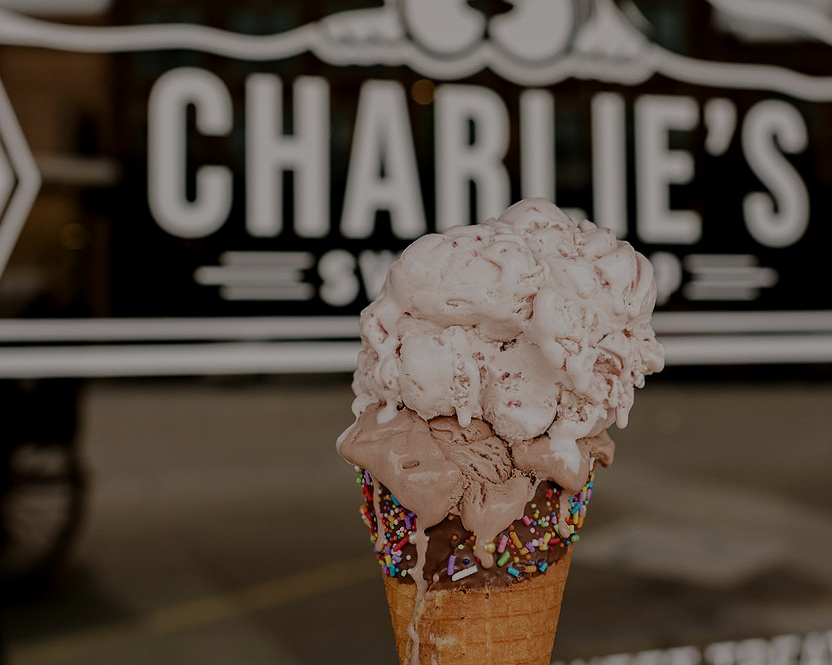 Hop across the street to Charlie's Sweet Shop! - Utterly delicious ice cream...homemade waffle cones...sprinkles...smiles, and more. Come get your sweet tooth on!
