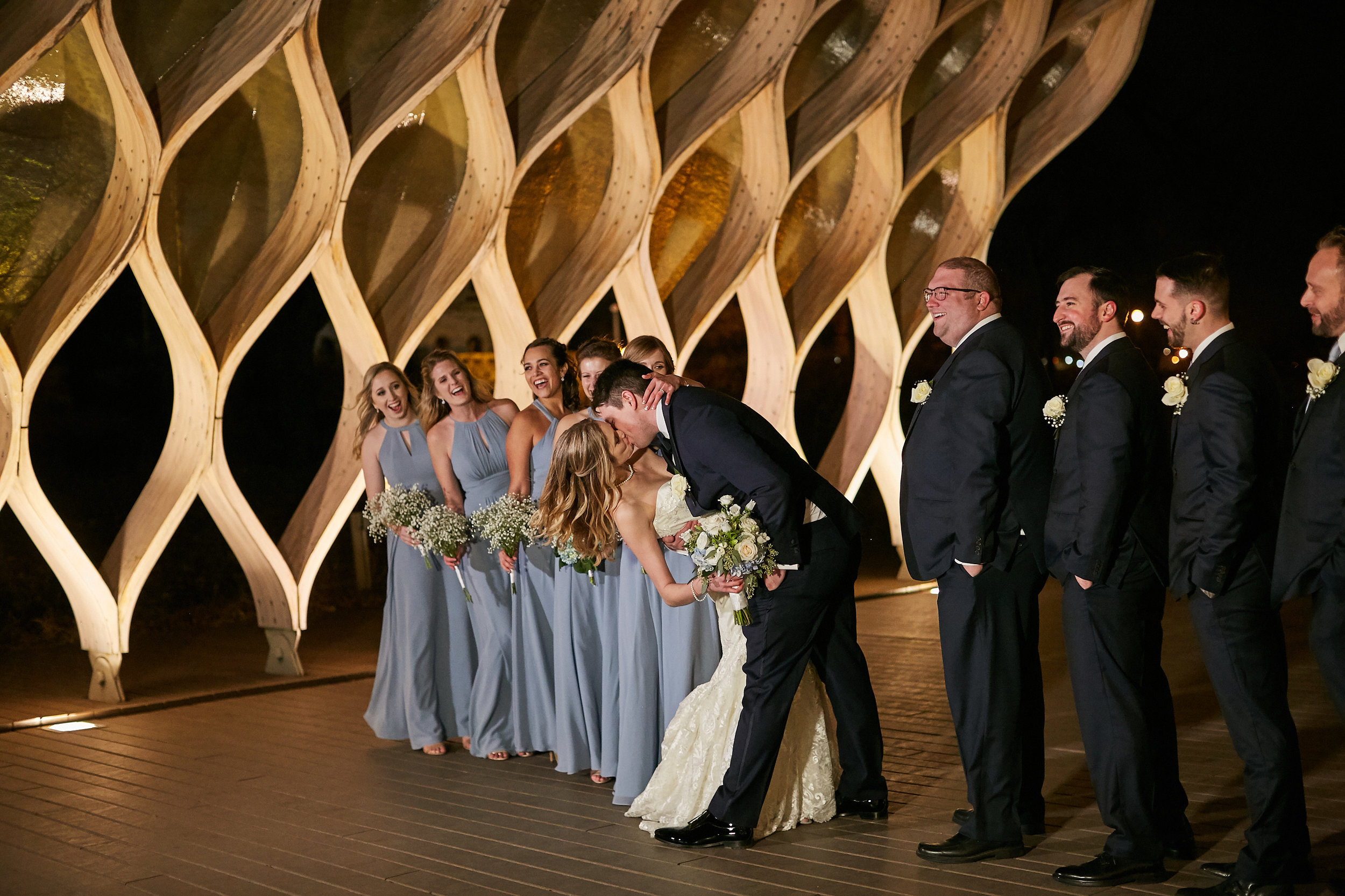 wedding day party photo lincoln park arch swoon dip bride groom