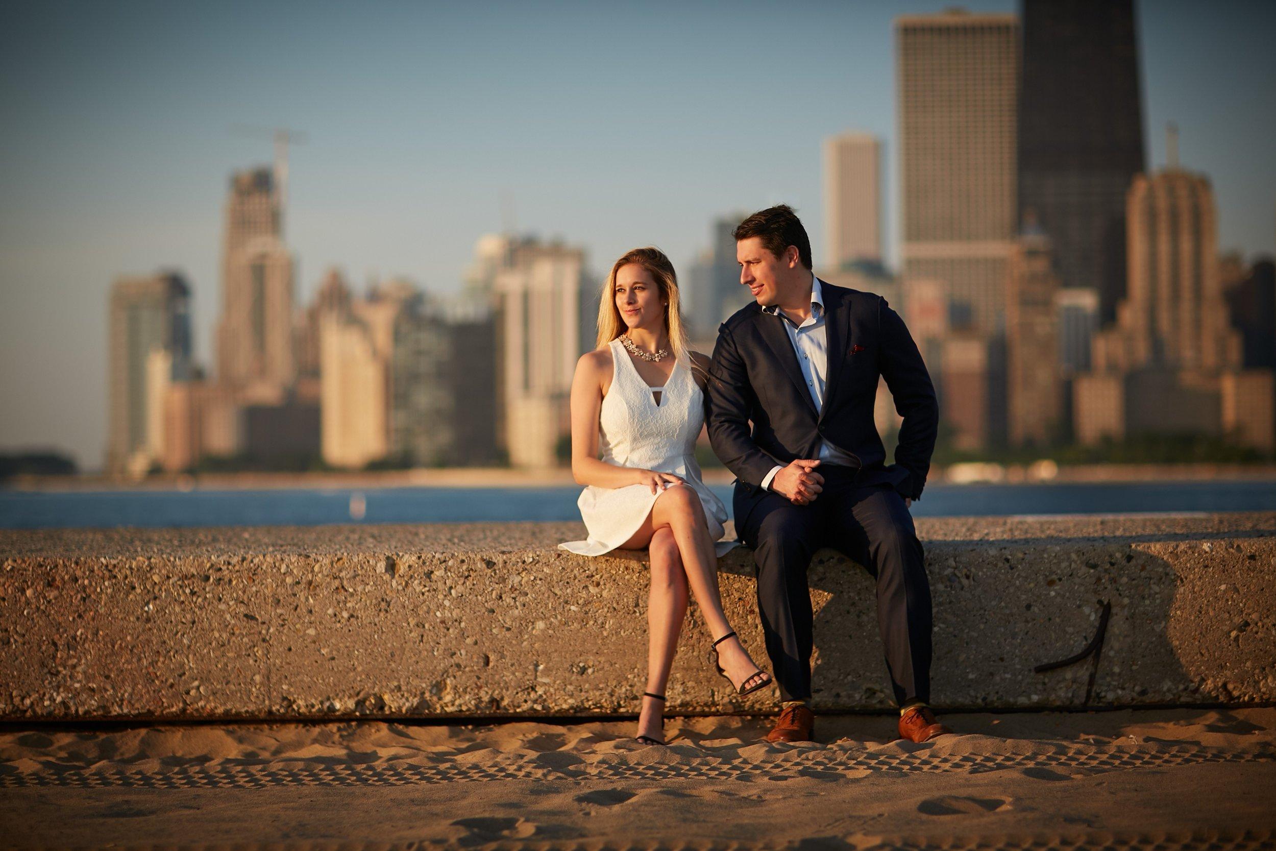 engaged couple photo chicago skyline beach
