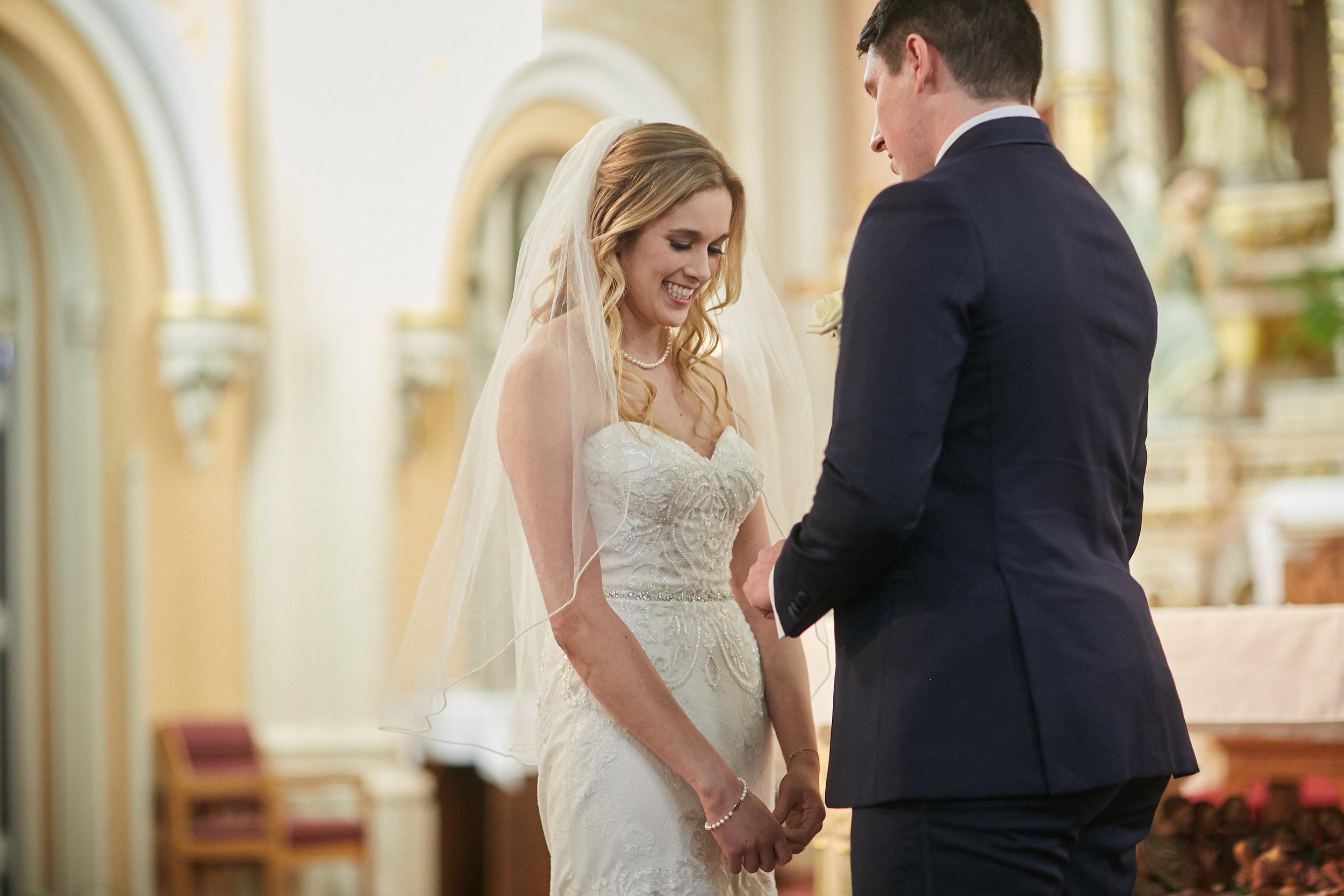 bride groom church wedding ceremony dress pearls veil vows