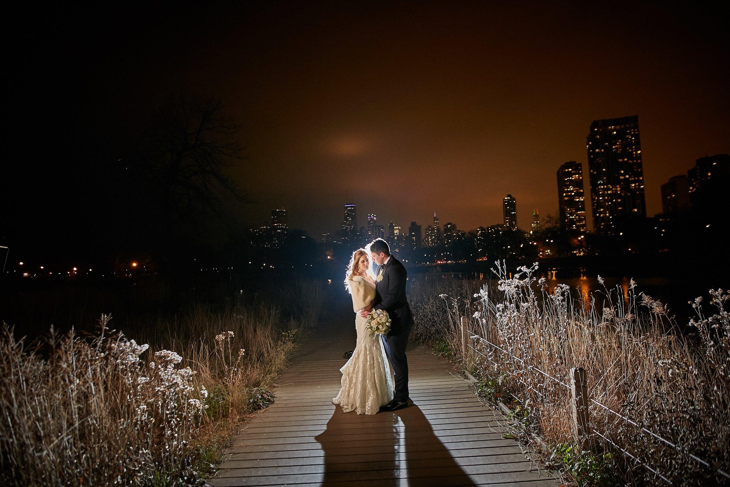 bride groom lincoln park night shot chicago sky line wedding photo