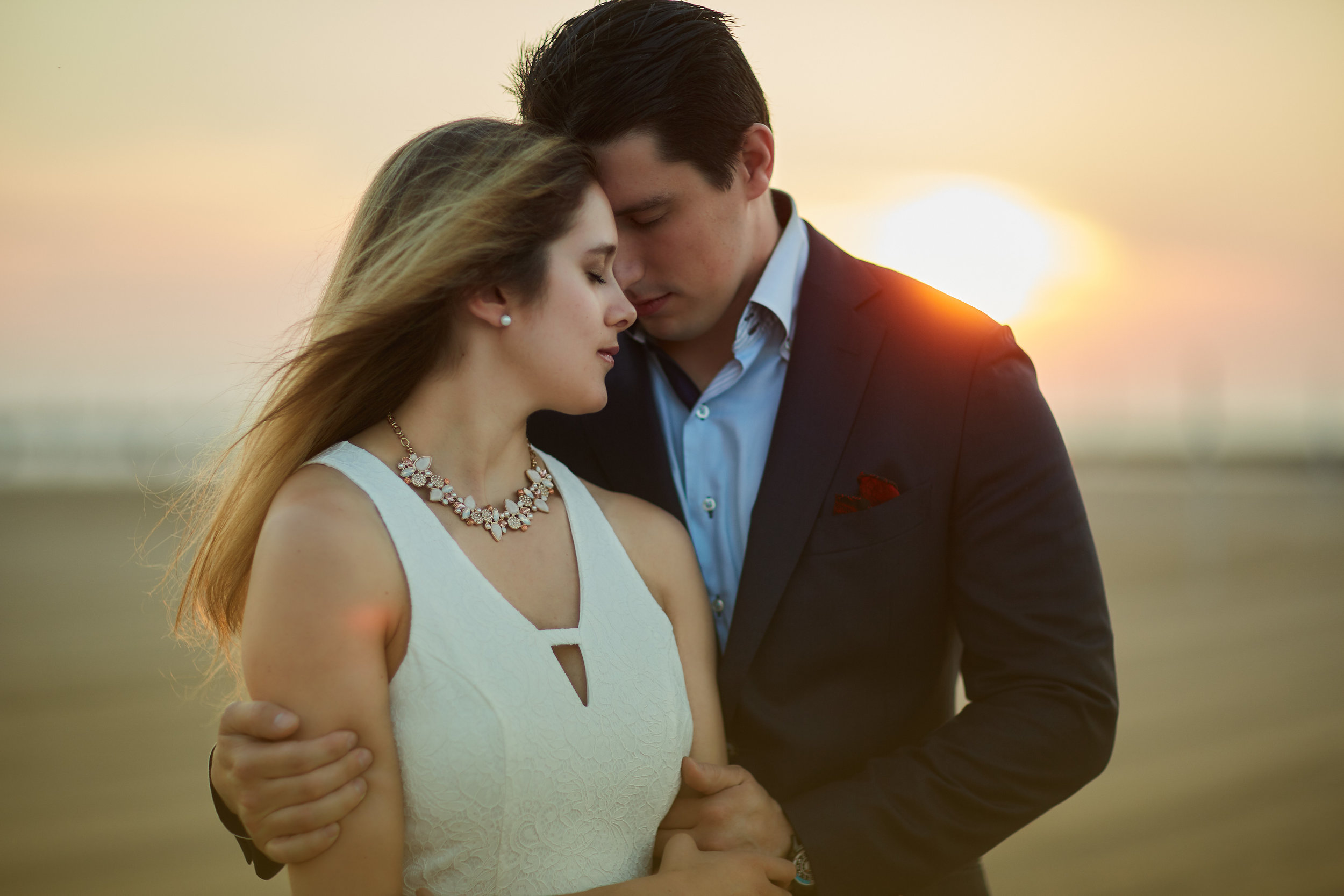 engaged couple photo shoot lake michigan chicago beach