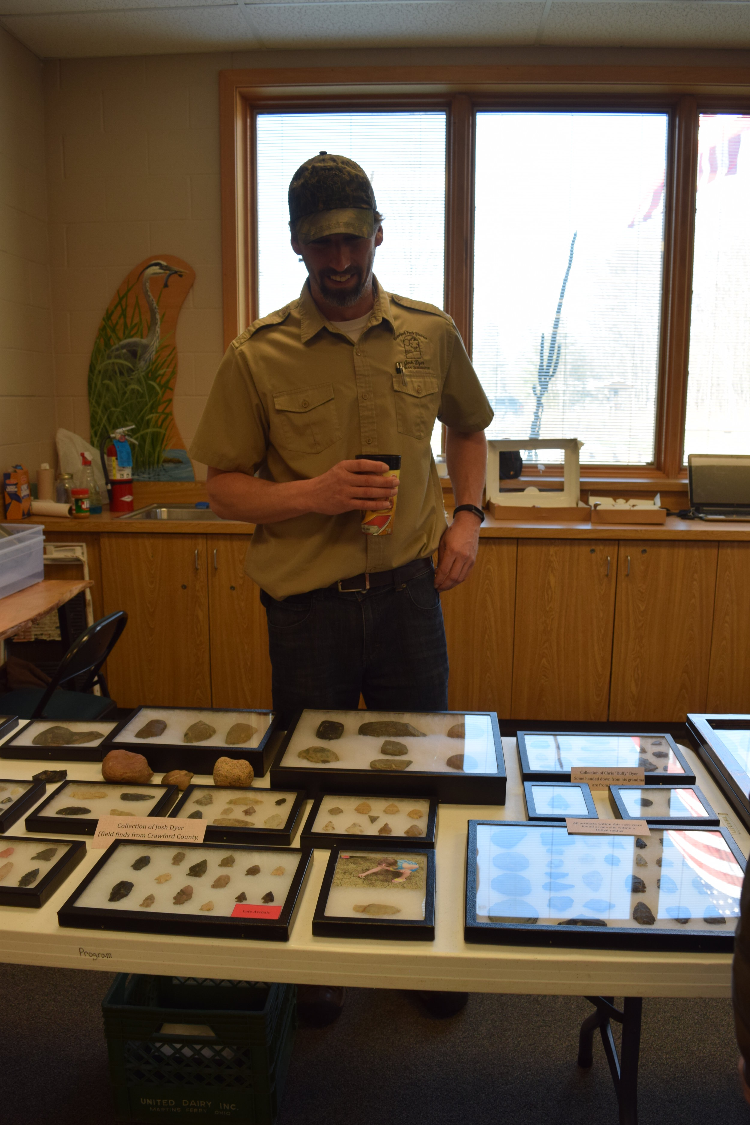 Josh Dyer, a member of Crawford County Parks District, with his collection of finds. Most artifacts were found in Crawford county.