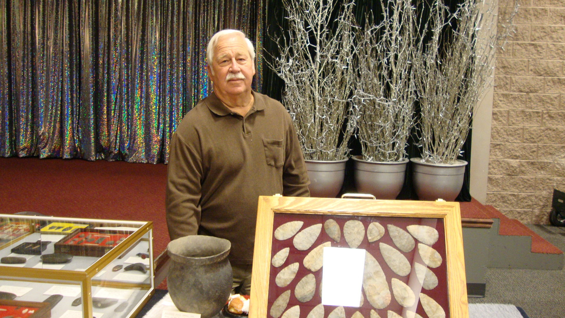 Steve Puttera with his display of finds from Cuyahauga County, Ohio