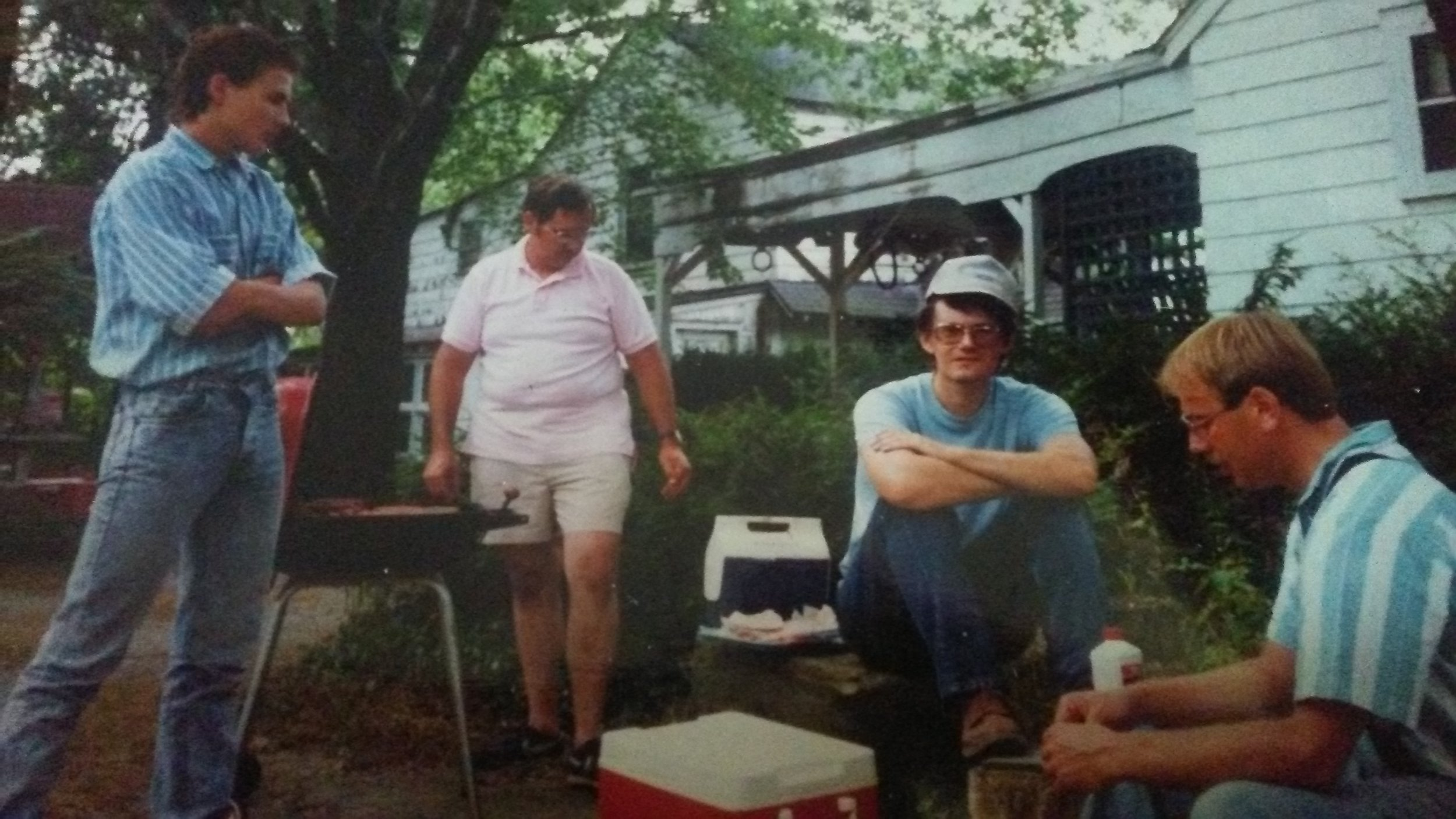 George Demuth manning the grill, with Dr. Jeb Bowen, Bill Young, and Jay Zimmerman (standing)at the Vietzen Picnic 1991
