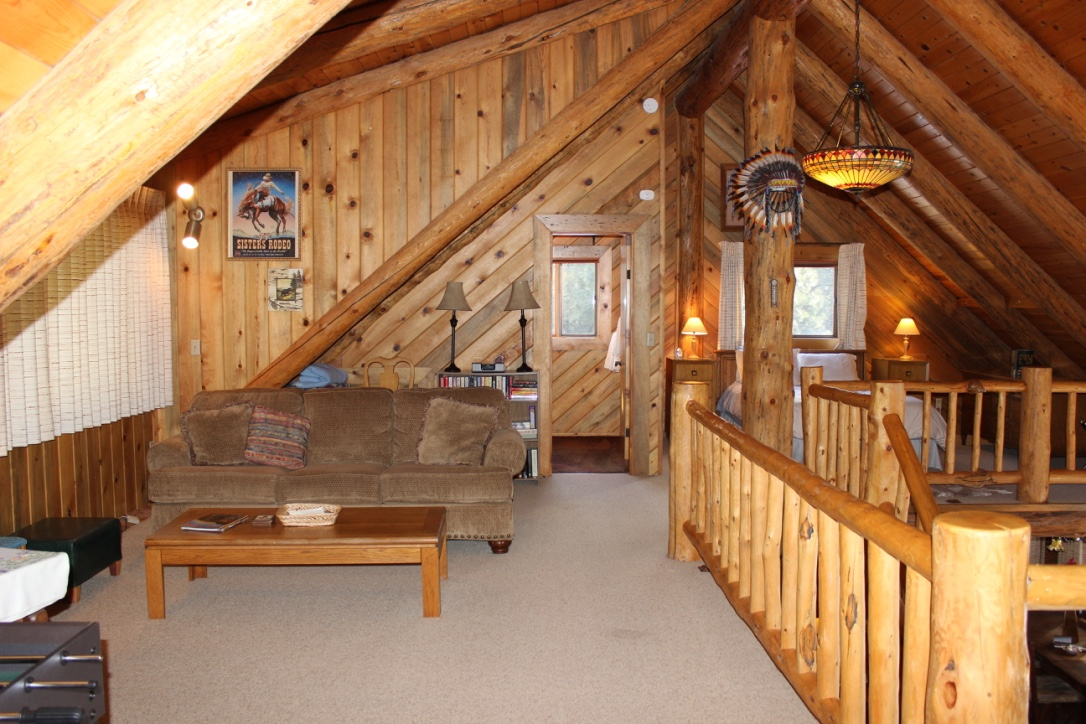 2 story log home-loft bedroom and TV-gamess