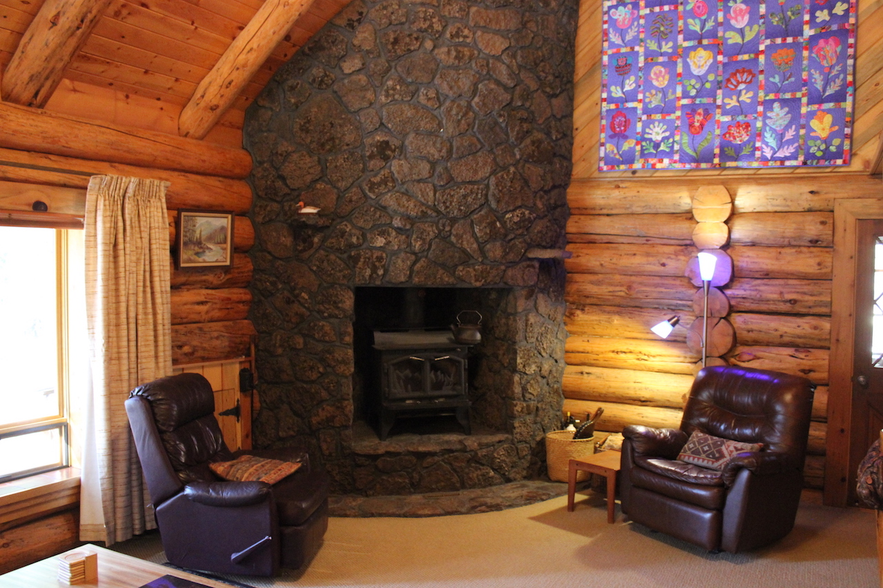 wood burning fireplace-floor to ceiling lava rock