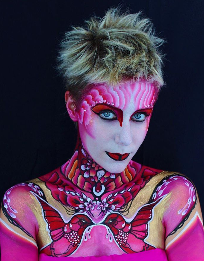 Pink bird face and body art by Brierley Thorpe.PNG