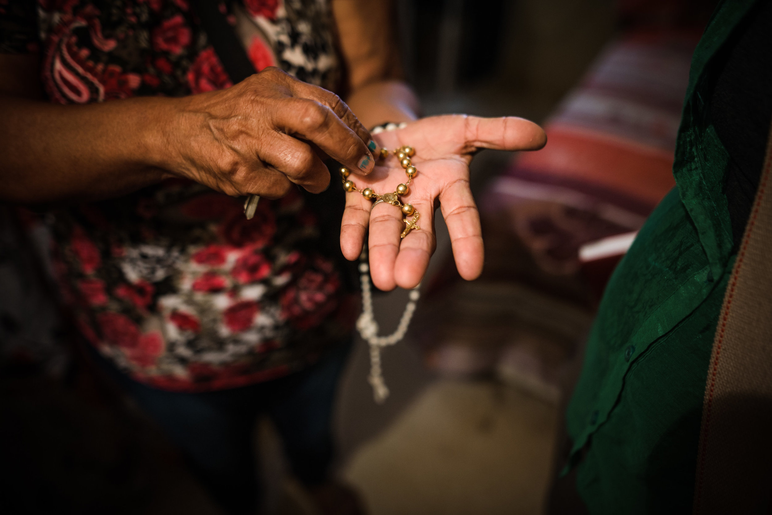 Photo credit: Aniya Emtage Legnaro  Dona holds strong to her faith as she shows us the Rosary she held onto for hours during the hurricane. Cantera, San Juan
