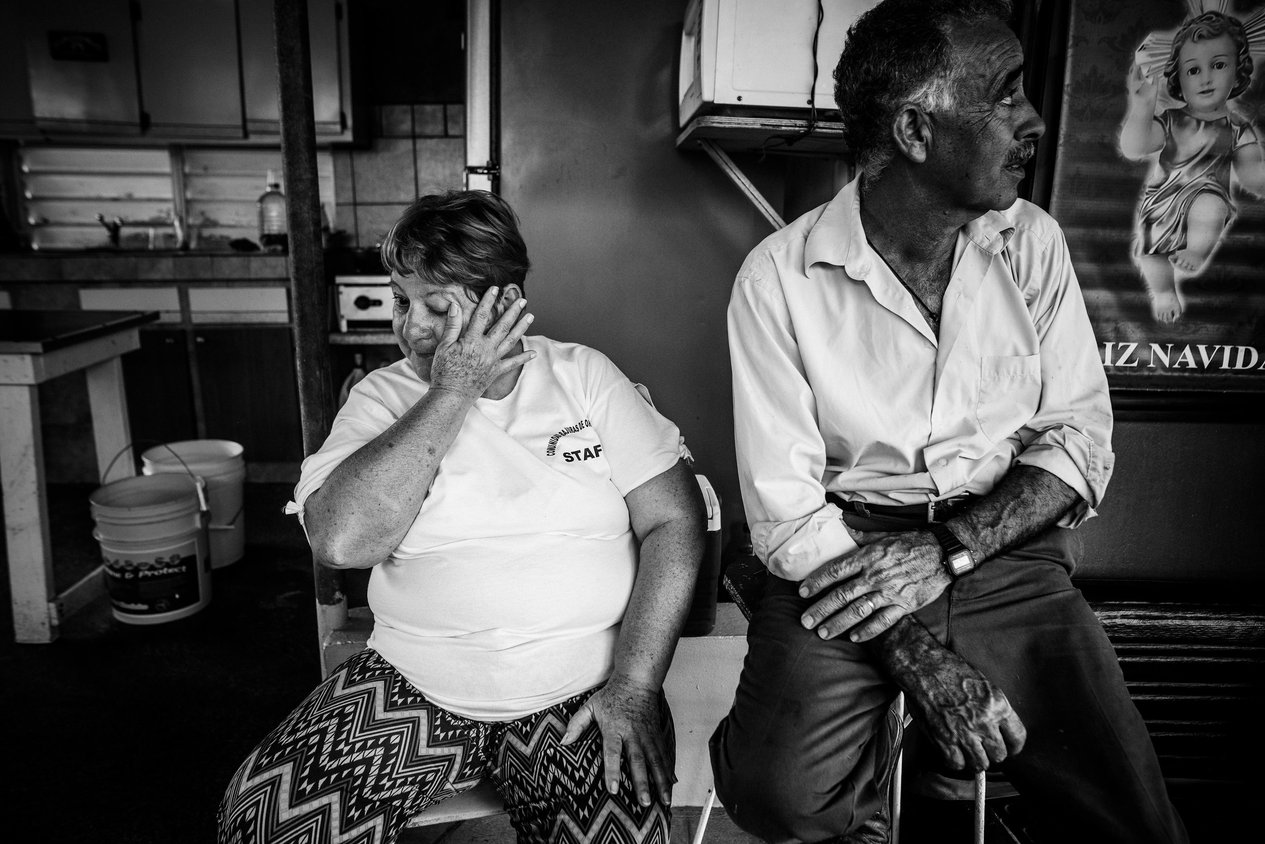 Photo credit: Aniya Emtage Legnaro  Juan's parents, Margarita and Juan Hernandez describe the day of Hurricane Maria. All of their children and grandchildren stayed together and she saw her son's home blow away. Orocovis, Puerto Rico
