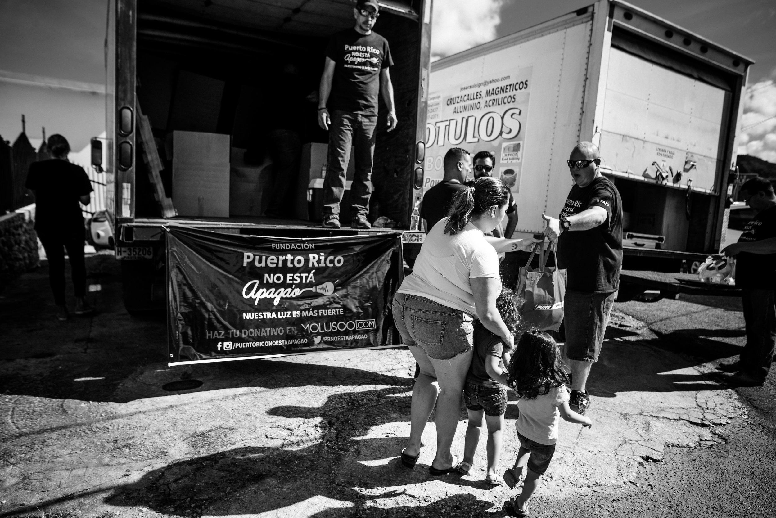 "Photo credit: Aniya Emtage Legnaro  ""Puerto Rico no esta apago"" – Puerto Rico is not shutting down. The campaign was started by Puerto Rican actor and stand up comedian to raise money for supplies such as food and books for those in need in Puerto Rico."