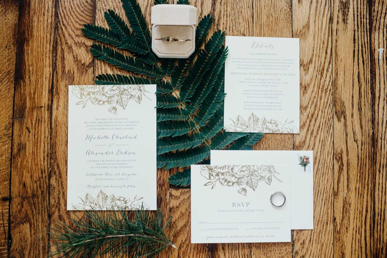 003_megan-graham-photography_invitation_rings_wedding_shenandoah_greenery.jpg