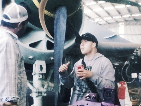 Levi chatting to teacher and support worker Craig Cole on a recent trip to the Caloundra Air Mueseum.