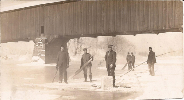 CuttingIceUnderCoveredBridge.jpg