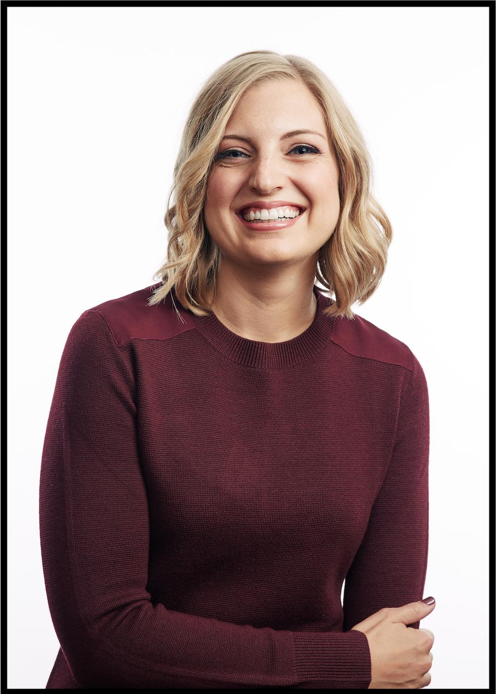 Stacy Kessler headshot laughing with black frame.jpg