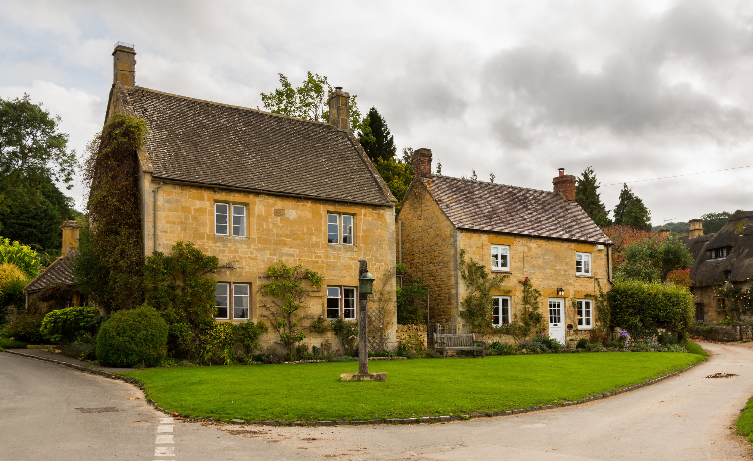 Beautiful sandstone village country cottages on road