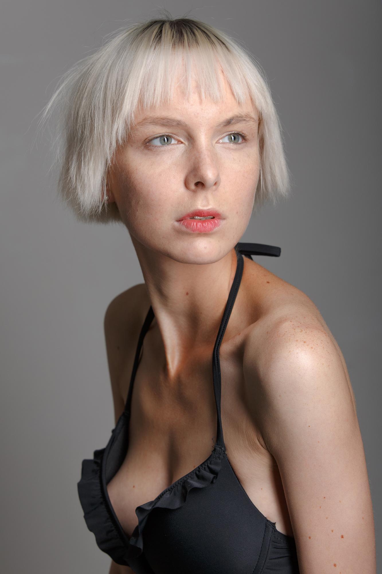 Female model with short white hair cosmetic studio portrait
